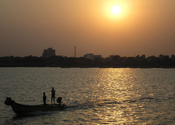 Sunset over the port of Chennai, India
