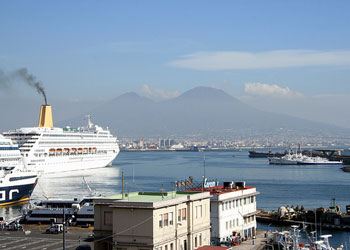 Cruise ship steaming out of Naples harbour, Vesuvius in background