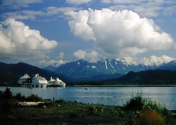 Cruise ships berthed next to the Seward Passenger Ship Terminal at the West Dock of Alaska Railroad's Dale R