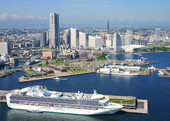 An aerial view of a cruise ship berthed at Yokohama cruise port, Osanbashi pier, Yokohama, Japan